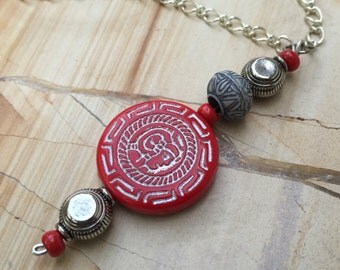 red figure bead pendant on silver tone chain