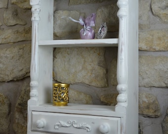 Pretty white wall shelf unit with drawer