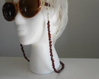 Eyeglass neck holders