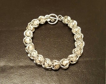 Captive Mother of Pearl Bracelet in Silver Tone