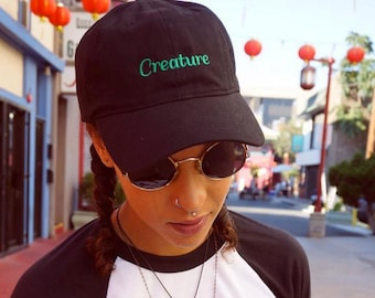 Black creature hat