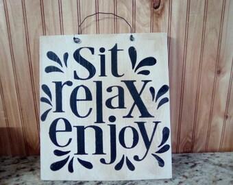 Sit, Relax, Enjoy Sign.
