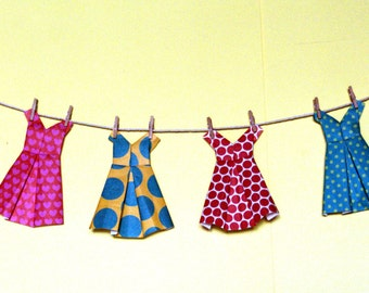 Six different and original paper dresses
