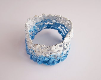 Knitted bracelet and attanetion