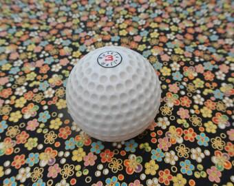 Novelty golf ball bottle opener with magnets