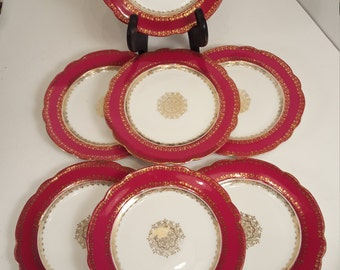 7 red & gold small medallion plates, saucers Austria; antique