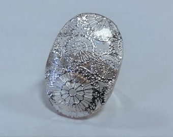 Clear and silver ring