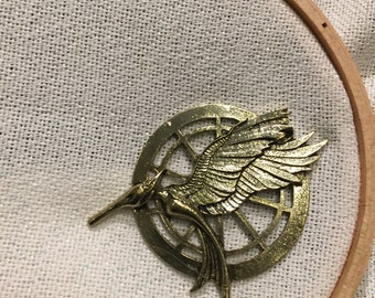 Hunger Games Needle Minder