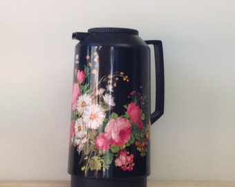 Add a touch of romance to your kitchen with this vintage summer floral thermos flask by floral.