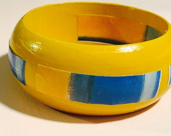 Bright yellow dome bangle with Mark Rothko decoupage detail