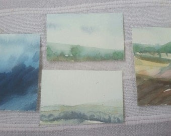 Tiny watercolour landscapes. Not mounted. Credit card sized. Designs and colours vary. Order more than one and create your own collage