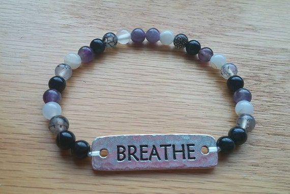 "7"" Breathe Bracelet. Black Onyx, Dragon Vein, Moonstone, Amethyst, Rose Quartz, ""Breathe"" plate on stretchy string. CF Awareness."