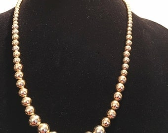 Stunning Napier gold tone bead necklace