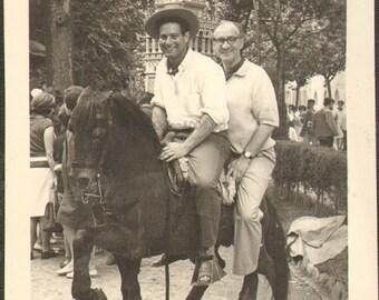 Spanish man and tourist riding black Paso Fino A004