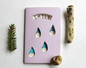 I Like People Who Smile When It's Raining - lilac notebook with raindrop elves. Gift for kids, pre teens, brother, sister, niece or nephew.