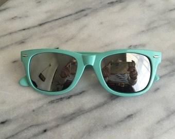 Light Aqua Wayfarer Style Sunglasses.