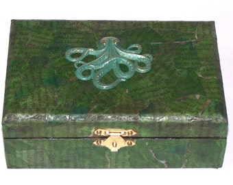 green Lovecraftian wooden box with likeness of Cthulhu on lid