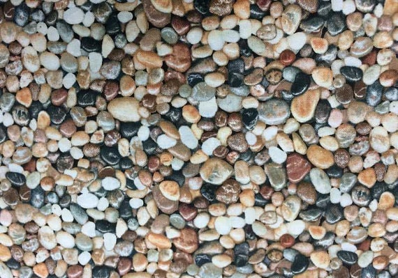 Rocks fabric gravel rock mexican beach pebbles rock landscape for Beach rocks for landscaping