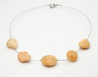 Contemporary necklace with desert 'pearls' from Wadi Rum, Jordan.  Thesys, ethical, environment, nature, middle east, bedouin, local, pebble