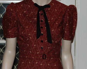 Swing Kittens, check this out. A fabulous WW11 reproduction dress