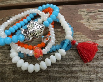 RESERVED Turquoise, Orange and White Stretch Bracelets with Glass, Crystals and Fish (Set of 5)