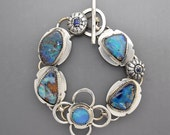 Five Opals with Sapphire Flowers