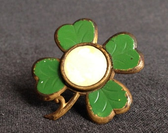 Lucky charm. Four leaf clover antique miniature frame support.