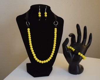 Black and yellow necklace, bracelet, and earrings set
