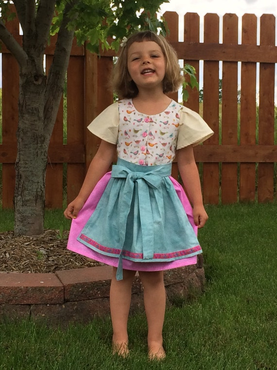 Toddler dirndl size4T (baby dirndl, baby trachten, Oktoberfest dress) Toddler dirndl size4T (baby dirndl, baby trachten, Oktoberfest dress) Toddler dirndl size4T (baby dirndl, baby trachten, Oktoberfest dress) Toddler dirndl size4T (baby dirndl, baby trachten, Oktoberfest dress) Toddler dirndl size4T (baby dirndl, baby trachten, Oktoberfest dress) ?zoom Request a custom order and have something made just for you. Item details 5 out of 5 stars. (392) reviews Shipping & Policies Here is a sweet little dirndl that will be something special for your little schnitzel to celebrate Oktoberfest in. The bodice features a sweet bird motif with hook closure (pink buttons cover up the hooks), pink skirt and an aqua apron with woven floral trim to really bring things together. The apron is detachable and in true German form can be tied in front. I'm making this design in limited supply this year, as my daughters grow I've thought about dirndls that can be passed on to their children in the future, this is one we will be offering for sale. Meet the owner of adasaccessories4me Learn more about the shop and process Max, Angie, Ada, Cora and Emma Toddler dirndl size4T (baby dirndl, baby trachten, Oktoberfest dress)