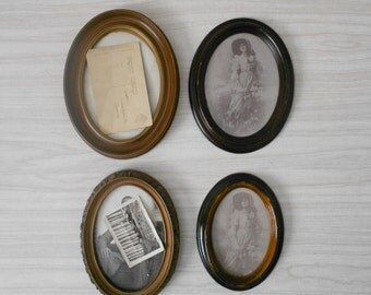 set of vintage oval faux wood brown picture frames / collage wall hanging