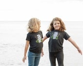 The Midwesterner Black Toddler Shirt. Grey Black Toddler Tee Celebrates the Midwest. Made in the USA.