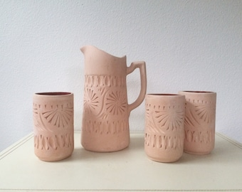 terracotta pitcher and cups