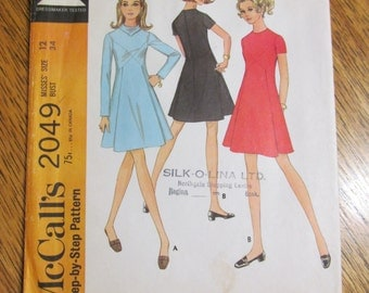 1960s MOD Unique Fit and Flare Dress with Criss Cross Seaming, Front Panel - Size 12 - UNCUT Sewing Pattern McCalls 2049