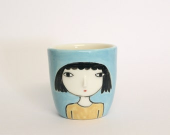 Handless cup / ceramic glass - high relief face