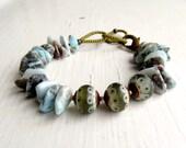 Tread Softly - handmade bohemian-style eclectic artisan bead bracelet in larimar blue and olive grey - Songbead UK, narrative jewellery