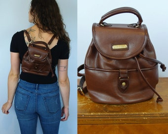 1990s 90s Vintage Brown Leather Mini Backpack by Liz Claiborne / Festival Convertable Cross Body Crossbody Bag Satchel Purse Tote Carryon