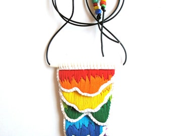 Hypoallergenic embroidered pendant necklace in rainbow colors black leather cord with rainbow glass beads hand embroidered on cream muslin