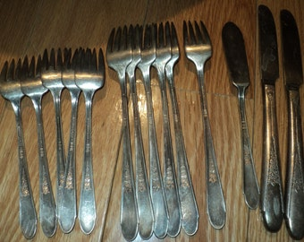 14 Piece Collection of William Rogers and Son Silver plated utensils consisting of 5 salad forks, 6 long forks, 2 knives and a butter knife