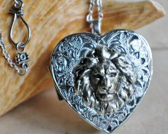 Silver lion music box locket, heart shaped locket with music box inside, in silvertone with lion.