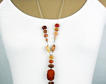 Long beaded chain necklace in shades of burnt orange and amber