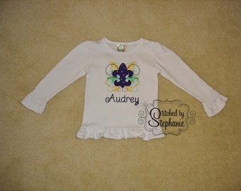 Girls Embroidered Personalized Monogrammed Purple Green Gold Mardi Gras Fleur de Lis Applique name White Long Sleeve Ruffle Shirt Bodysuit