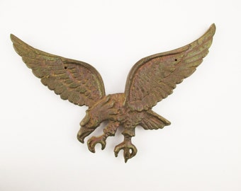A Cast Bronze Eagles -  Detailing on the Front  - Attachments on the Back - Cast Bronze - Eagle - Sharp Beak and Over-sized Talons - Impact
