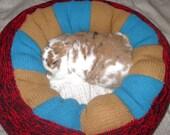 large plump Ugli Donut bunny bed chunky wool