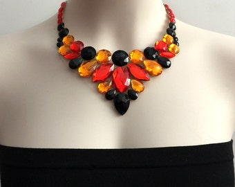 bib necklace. red jet balck and orange rhinestone statement necklace