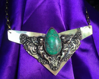 Clarity. Brass deco bib necklace with green impression jaser semi precious teardrop stone and victorian brass angels.