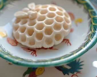 Mini Honey Bee Soap Sitting on a Honeycomb made with Honey