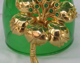 Large Gold Toned Metal Flower Brooch with Emerald Green Rhinestone Stamens, Vintage
