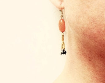 Dangling long earrings gold to the gold end and pearls