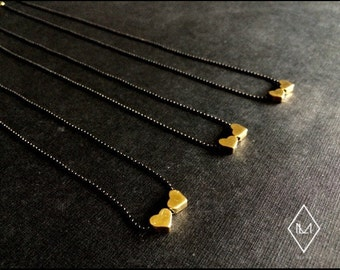 Tiny Brass Heart Chain short from ALMA