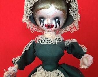 Dee Mons is a OOAK vampire art doll